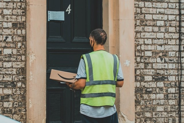 Amazon delivery driver in the UK delivering a package